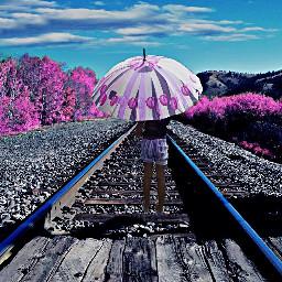 fterailway pink umbrella sky blue
